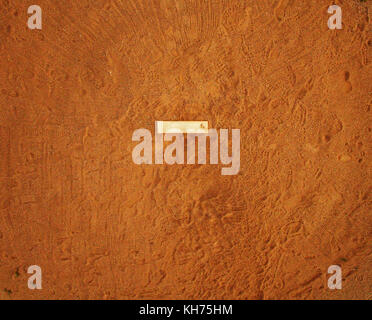 Pole aerial High Dynamic Range (HDR) image of a baseball pitcher's dirt mound with pitching slab and many footprints. - Stock Image