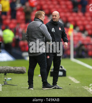 Hampden Park, Glasgow, UK. 14th Apr, 2019. Scottish Cup football, semi final, Aberdeen versus Celtic; Celtic Caretaker Manager Neil Lennon is congratulated by Aberdeen reserve team coach after manager Derek McInness and assistant manager Tony Docherty were both sent to the stand Credit: Action Plus Sports/Alamy Live News - Stock Image