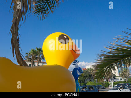 a big inflatable rubber duck on the street of Marina Di Massa, Italy - Stock Image