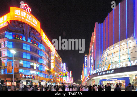 Shanghai, China-November 29, 2011: Neon signs on Nanjing Road at Night. Nanjing Road is the most famous  shopping street in China with over 600 stores - Stock Image