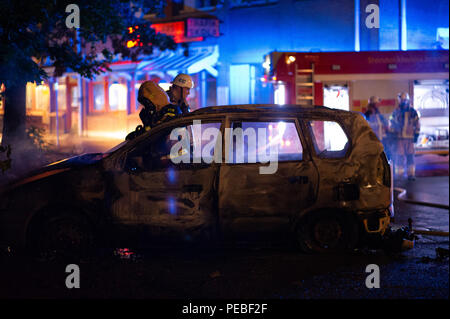 Stockholm, Sweden, August 14, 2018. Another car fire in Sweden. Here in Stockholm archipelago, Gustavsberg. Extinguishing of car fire outside Stockholm. Credit: Barbro Bergfeldt/Alamy Live News - Stock Image