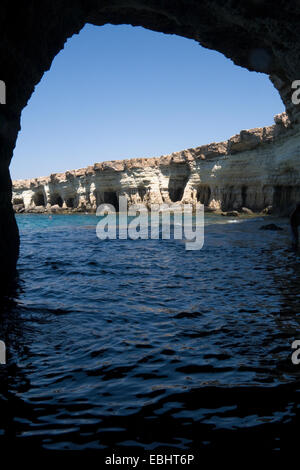 Looking out from a natural cave at the Sea Caves, Cavo Greco, not far from Ayia Napa, Cyprus. - Stock Image