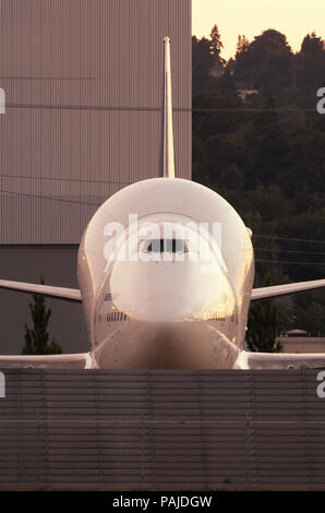 nose of a Boeing 747 LCA Dreamliner parked at dusk. Part of the special Boeing 7-series airliner customer party airshow celebrations on the eve of the - Stock Image