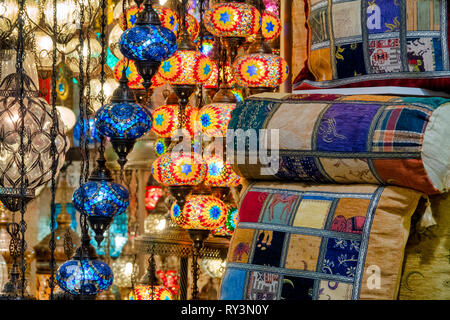 Close up shot of a hanging mosaic lamp and cushions in the Grand Bazaar, Istanbul, Turkey - Stock Image