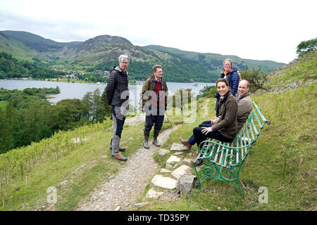 The Duke and Duchess of Cambridge sit on a bench at Deepdale Hall Farm, a traditional fell sheep farm, in Patterdale, during a visit to Cumbria. - Stock Image