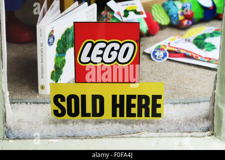 Lego sold here sign. - Stock Image