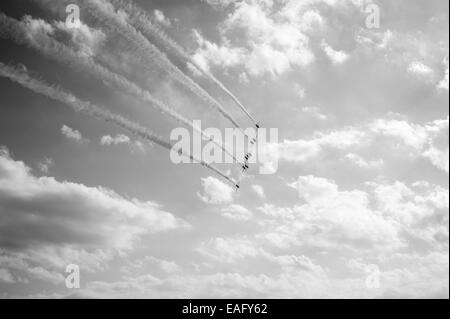 Red Arrows flying display at Malta International Airshow 2014, flying away in formation - Stock Image