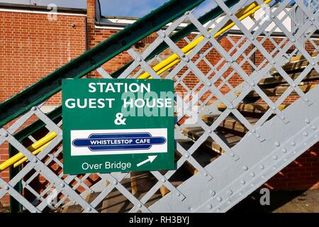 Station guest house and whistlestop cafe over the bridge. Notice by the railway station. Woodbridge, Suffolk, UK. January 2019. - Stock Image