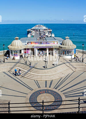 A view of the Pier from the seafront on the North Norfolk coast at the resort of Cromer, Norfolk, England, United Kingdom, Europe. - Stock Image