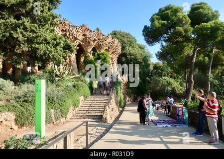 Barcelona, Spain, October 2018. People enjoying a hot sunny morning at Gaudi's Park Guell. - Stock Image