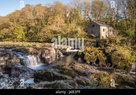 Wide angle long exposure of Cenarth Falls and old water mill, Cenarth, Wales, UK - Stock Image
