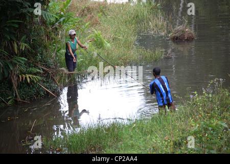 Two Malagasy Youths Fishing, Madagascar, Africa - Stock Image