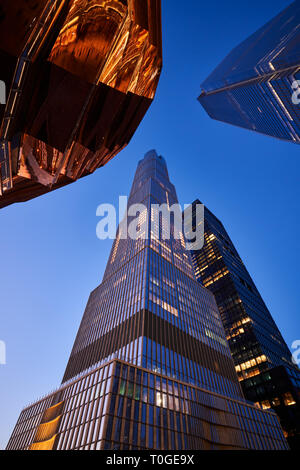 15 Hudson Yards skyscraper with part of The Vessel staircase at dusk. Midtown Manhattan West. - Stock Image