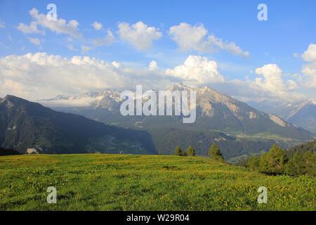 Mountain range seen from Obermutten, Canton of Grisons, Switzerland. - Stock Image