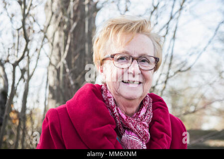 Portrait of old woman smiling - Stock Image
