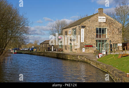 Former canal warehouse(1815)(now a cafe)  Leeds and Liverpool canal, Foulridge Canal Wharf, Warehouse Lane, Foulridge, Pendle, Lancashire, England, UK - Stock Image