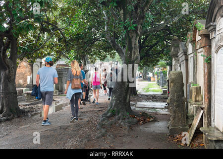New Orleans Cemetery, view of tourists visiting Lafayette Cemetery No.1 in the Garden District of New Orleans, Louisiana, USA - Stock Image