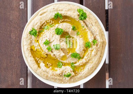 Vegan baba ghanoush, a levantine appetizer of mashed cooked eggplant mixed with tahini, olive oil, and various seasonings - Stock Image