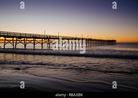 Sunset Beach pier at sunrise, Sunset Beach, North Carolina, United States - Stock Image