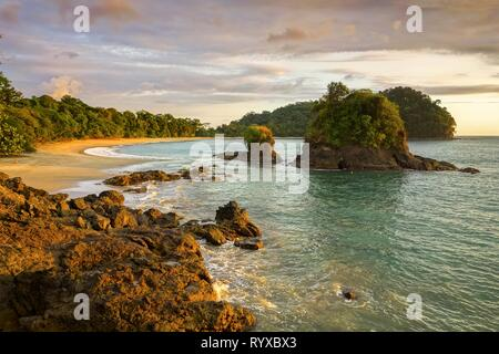 Scenic Sunset View and Dramatic Landscape of Playa Espadilla Beach in Manuel Antonio National Park Costa Rica - Stock Image