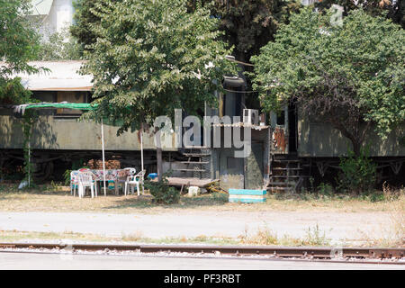 An abandoned train carriage being lived in, Thessaloniki, Greece - Stock Image