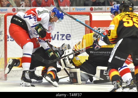 Karlovy Vary, Czech Republic. 18th Apr, 2019. (L-R) Radim Zohorna of Czech Republic, Dominik Bittner, Niklas Treutle and Tim Wohlgemuth of Germany in action during the Euro Hockey Challenge match Czech Republic vs Germany in Karlovy Vary, Czech Republic, April 18, 2019. Credit: Slavomir Kubes/CTK Photo/Alamy Live News - Stock Image