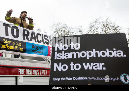 London, UK. 16th March, 2019. Ricardo la Torre, Regional Secretary of the Fire Brigades Union (FBU) Eastern Region addresses thousands of people on the March Against Racism demonstration on UN Anti-Racism Day against a background of increasing far-right activism around the world and a terror attack yesterday on two mosques in New Zealand by a far-right extremist which left 49 people dead and another 48 injured. Credit: Mark Kerrison/Alamy Live News - Stock Image