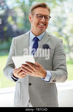 Businessman laughing - Stock Image