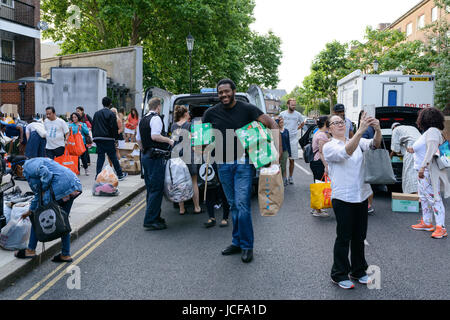 London, UK. 15th June, 2017. Volunteers unloading donations for the residents of Grenfell Tower who lost everything - Stock Image