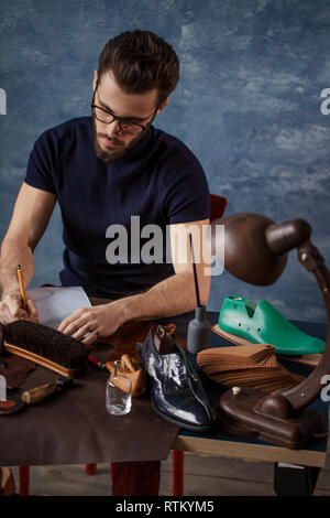 guy attending design school, close up photo. man preparing the report for boss at work - Stock Image