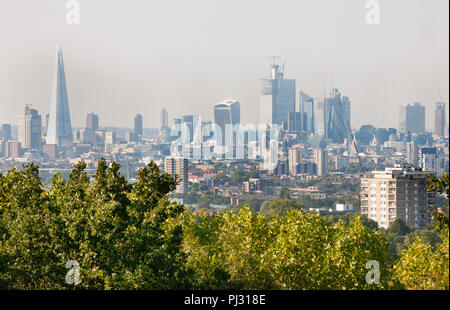 View over City of London skyline from One Tree Hill, Honor Oak, Southwark, London, United Kingdom - Stock Image