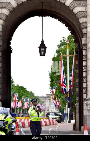 London, England, UK. Metropolitan Police officers on duty around The Mall during Donald Trump's State Visit, 3rd June 2019 - Stock Image