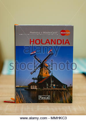 Poznan, Poland - March 23, 2018: Polish Pascal travel book about the Netherlands on a table - Stock Image
