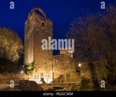 The Floodlit Bell tower in Peratallada: One of the key features that distinguishes this ancient stone village is the high towers for defense. - Stock Image