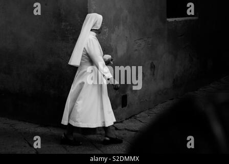 Nun turning a corner - Stock Image