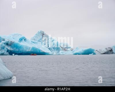 Enormous icebergs floating on a glacial lagoon in southeastern Iceland - Stock Image