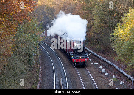 Jubilee Class locomotive 45699 'Galatea' passing Sowerby Bridge on the Calder Valley line with a special - Stock Image