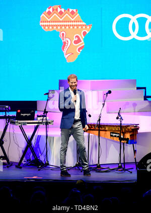The Duke of Sussex speaks on stage at the Sentebale Audi Concert 2019 held at the Hampton Court Palace in London. The Sentebale concert raises awareness and vital funds for the Duke of Sussex's charity, Sentebale, which helps young people in southern Africa affected by HIV. - Stock Image