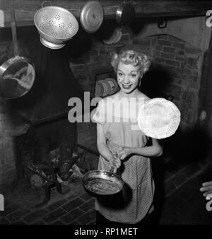 Mrs Richard Heane tossing a pancake on Shrove Tuesday 1951. February 1951 B608 -003 - Stock Image