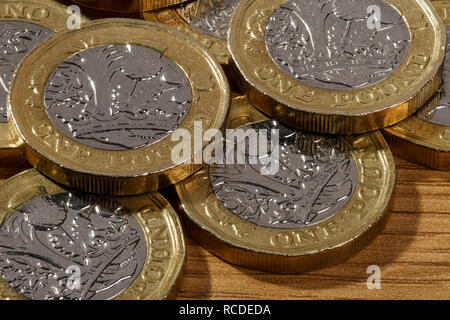 Macro close up detail of some one pound coins - Stock Image