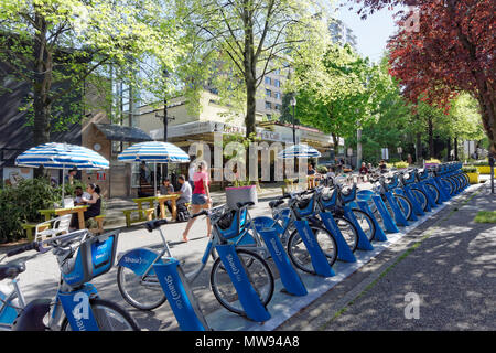 Mobi bike share bicycles and pedestrians only area on Thurlow Street in downtown Vancouver, BC, Canada - Stock Image