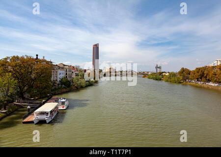 Sevilla Tower, Seville, Spain taken from Isabella Bridge - Stock Image