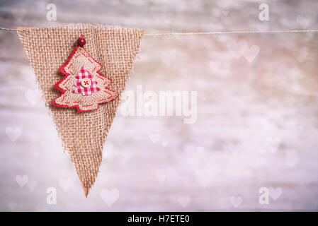 Christmas background with Christmas ornaments on wooden board - Stock Image