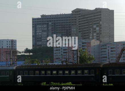 Tower blocks seen as approaching Pyongyang, North Korea - Stock Image