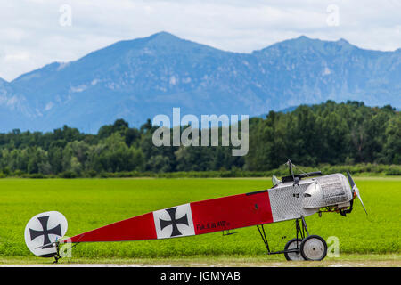 German airplane Fokker E III 410 replica from First World War without wings with mountains in the background. - Stock Image