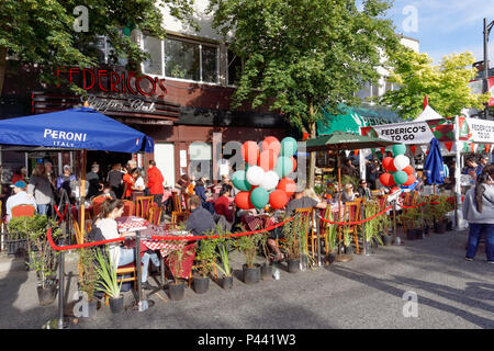 People eating outdoors at Italian Day 2018 celebrations on Commercial Drive, Vancouver, BC, Canada - Stock Image