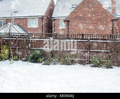 New build houses in winter snowing - Stock Image