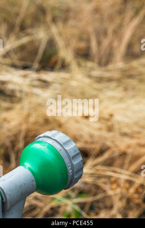 Garden hosepipe spray gun - as metaphor for 2018 heatwave and drought, and hosepipe ban. - Stock Image