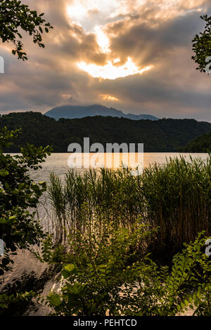 Sunset over the lake at Levico Terme, Trentino, Italy - Stock Image