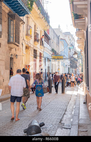 Tourist take in the street sights in old Havana Cuba. - Stock Image